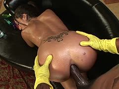 Black guy with rubber gloves bangs a Latina's oiled ass