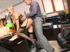 Secretary in nylons is nailed in the office