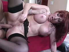 Redheaded milf in nylons is fucked