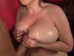 Cock between Desiree Dulaca's boobs