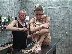 Young slave is extremely hogtied