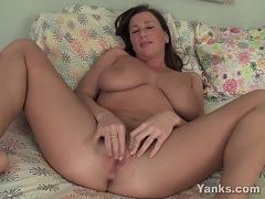 Busty mom lolls on her bed