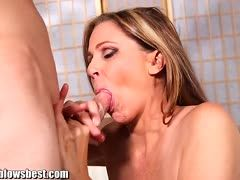 Julia Ann makes him happy with her blowjob
