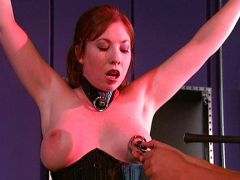 Female slave is torn on her nipples