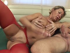 Mom in suspenders is woken up by a hard cock