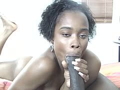 Black woman sucks a giant prick